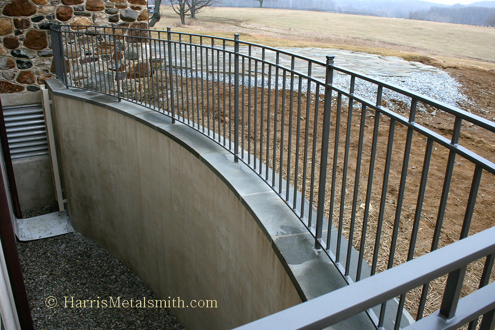 Custom-Basement-Railing-with-Egress-Ladder.jpg