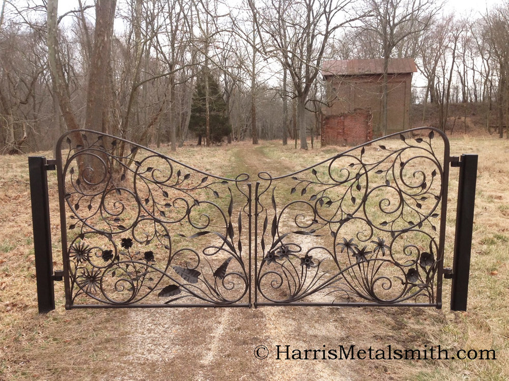 These gates were designed to be hung between 2 stone pillars, they are displayed here on a temporary stand.