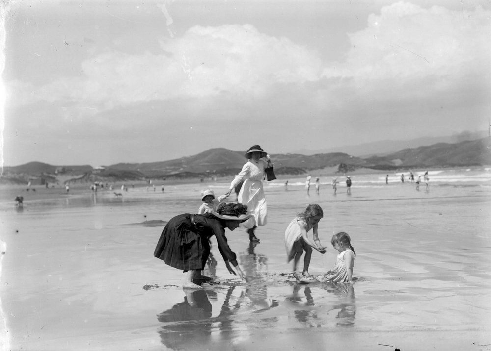 Women and children at the beach