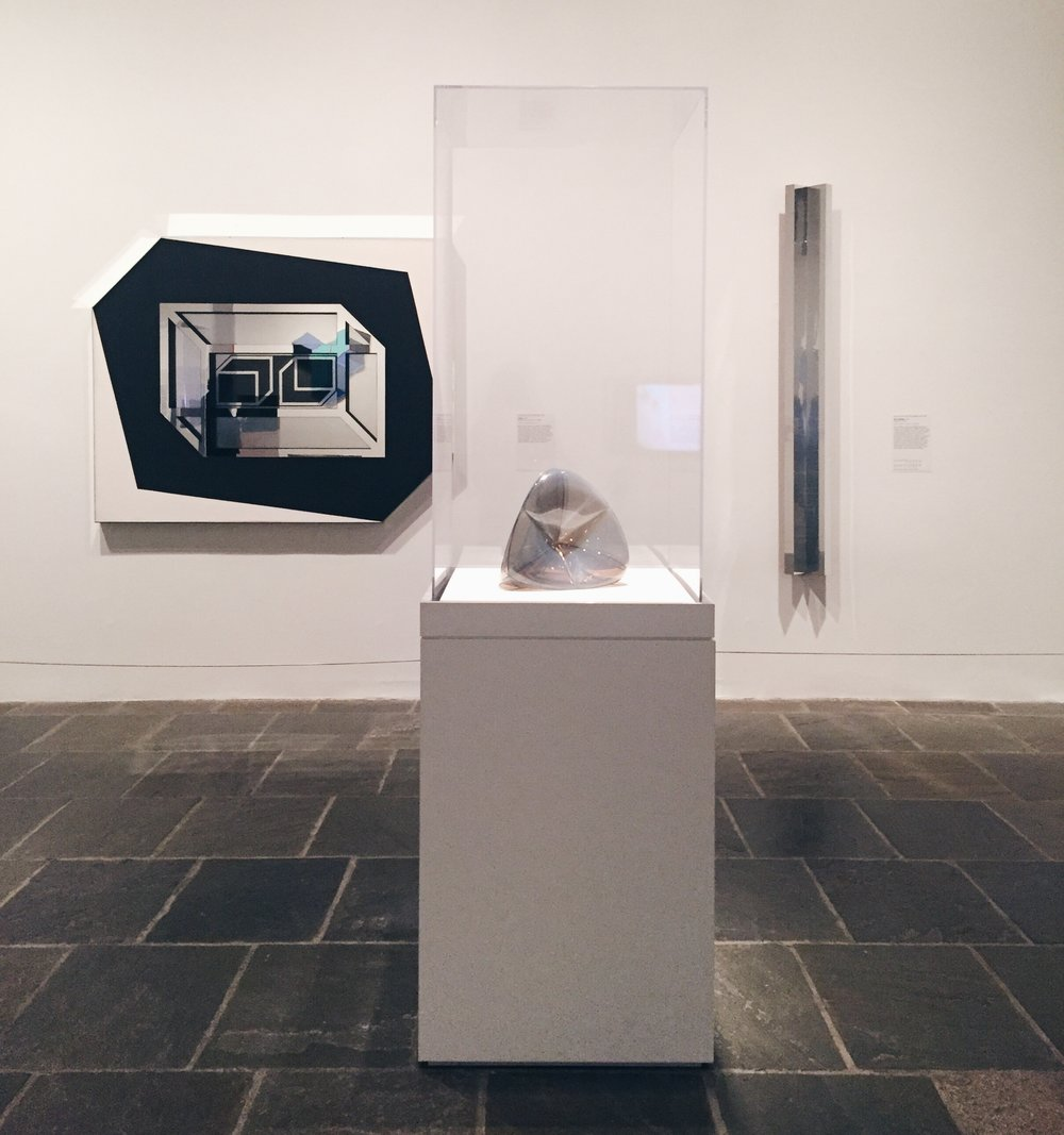 Left to right: Larry Bell,  Untitled . Ruth Volmer,  Steiner Surface .