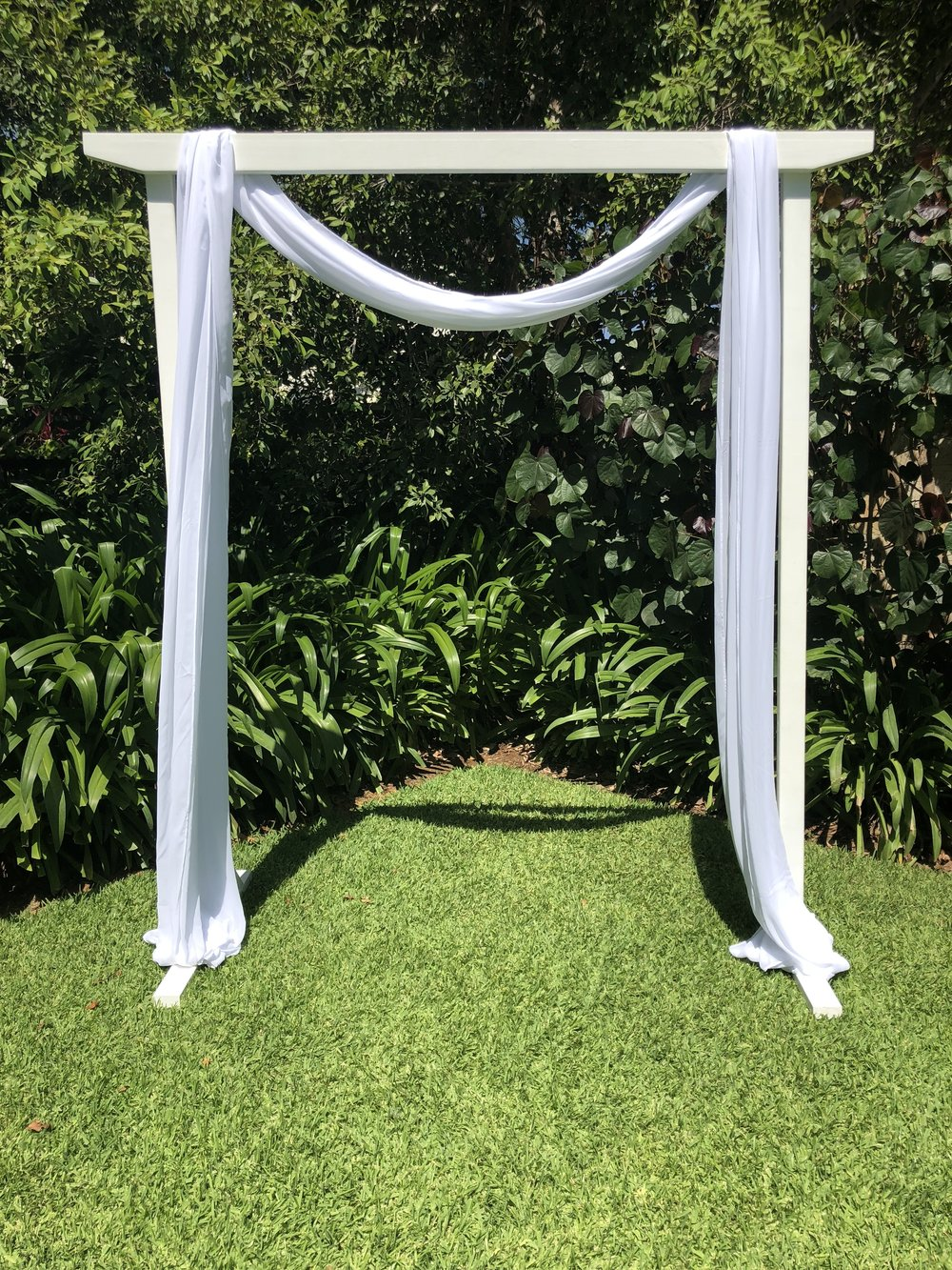"""White wooden arbour """"AVA"""" with dressing $190 - We can drape dressings any style you like- send us your inspiration pictures!"""