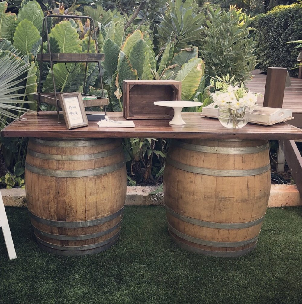 Wine Barrel Table: $150 - Perfect for a guestbook/wishing well table, grazing table, desserts table or a bar table
