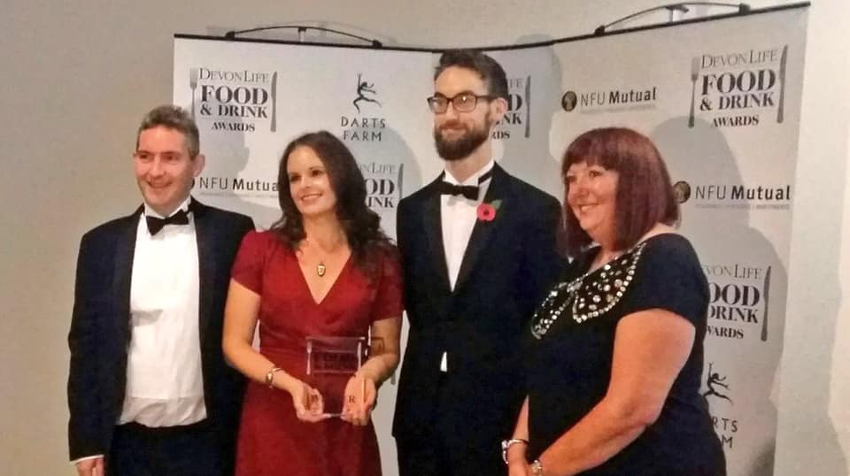 "In November 2018, we won the title of ""Best Devon Sunday Roast"" at the Devon Life Food and Drink Awards. From left to right: Owners James and Charlie Garnham, Head Chef Liam Murray and our judge from cottages.com, Sherliee Jordan."