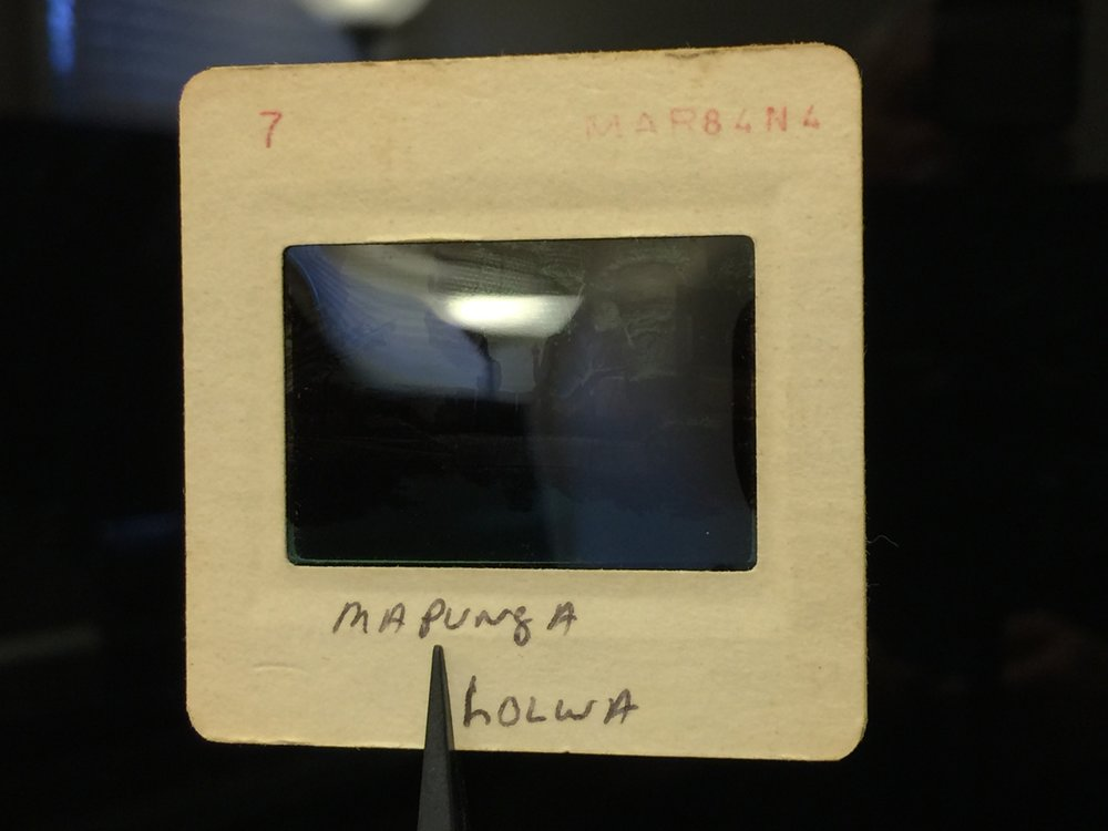 Non-emulsion side: Shiny and curves toward you. Also frame shows slide number and date developed in red printing. Click to enlarge.