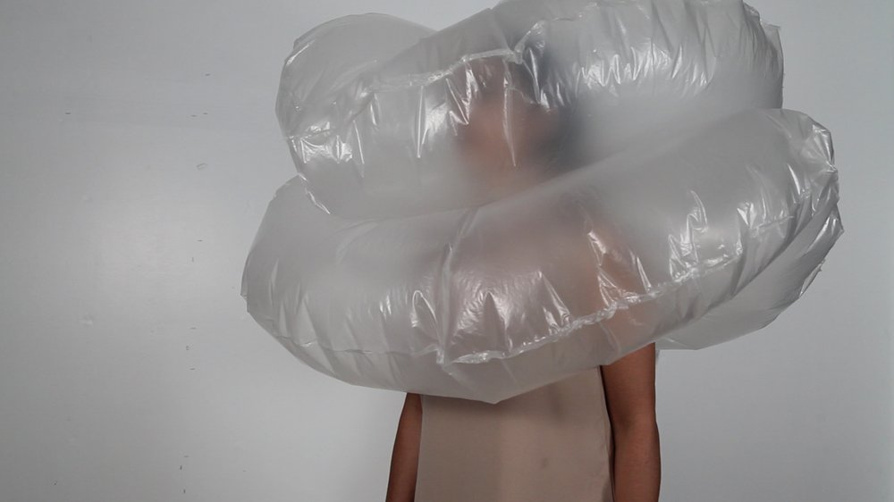 Video still from 'Double Donut Inflatable Collar'