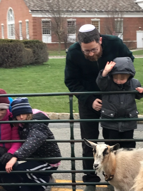Roni Kotel, member of Maplewood Jewish Center and Kushner parent with his young son Erez at Yom Ha'Atzmaut celebration petting zoo.jpeg