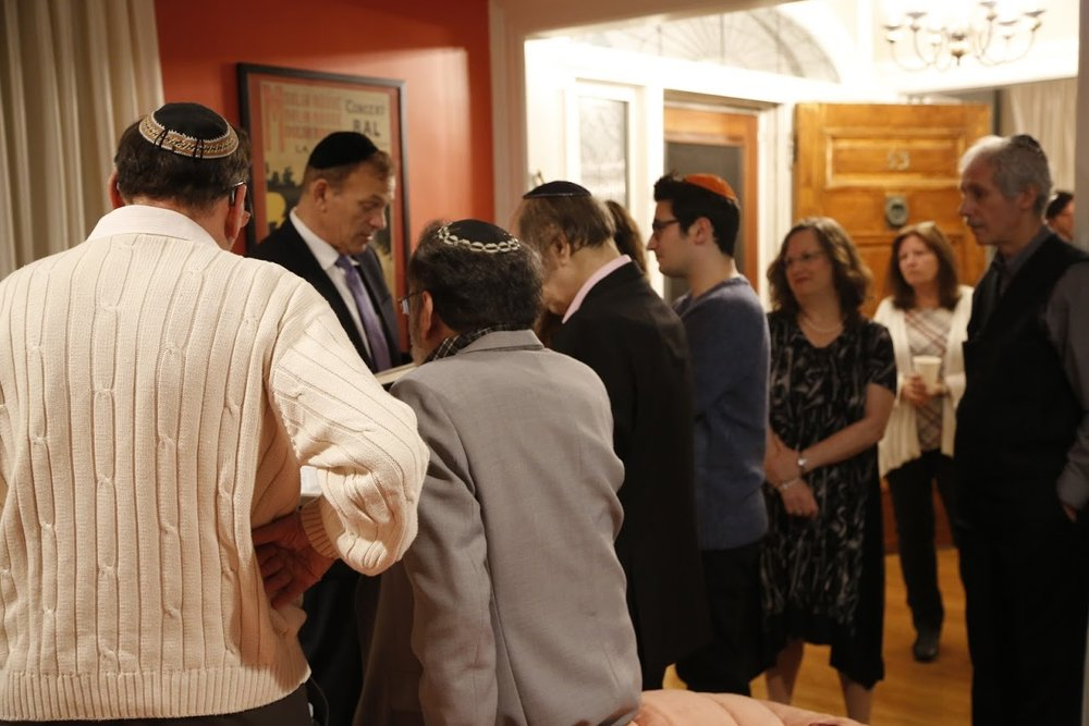 December 23, 2018. At our home, on the day of Rina and Eric's engagement party, Rabbi Fishman conducts mincha (afternoon prayers) yahrzeit (an anniversary that commemorates a death according to the Jewish date) services in memory of my mother with my brothers Nate, Al and Stu, Rina (next to Eric), Eric, Arnee, and me gathered around with other family and friends. He then spoke lovingly about Rina's four grandparents, whom he knew, and gave Rina and Eric a beautiful entrée into the day of the marriage ceremony.