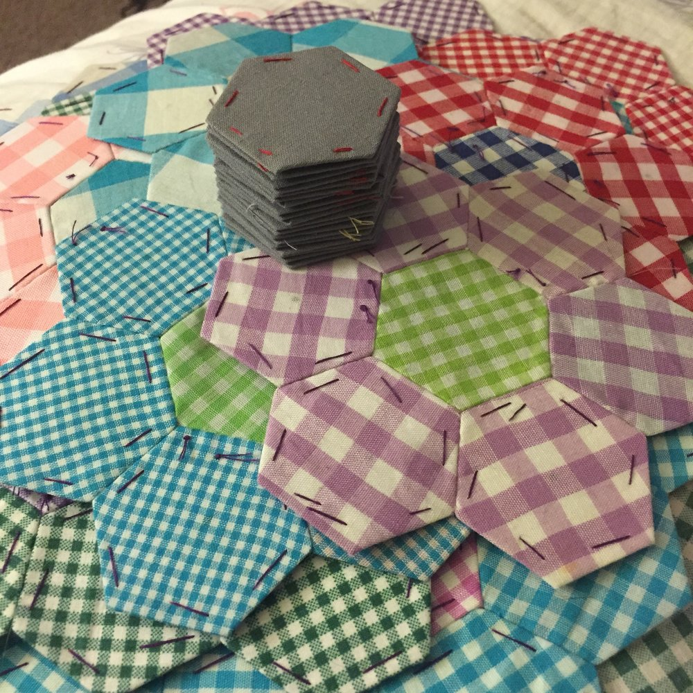 hexie gingham flower quilt i've been working on forever.  little bit here and there and eventually it will get done, right?