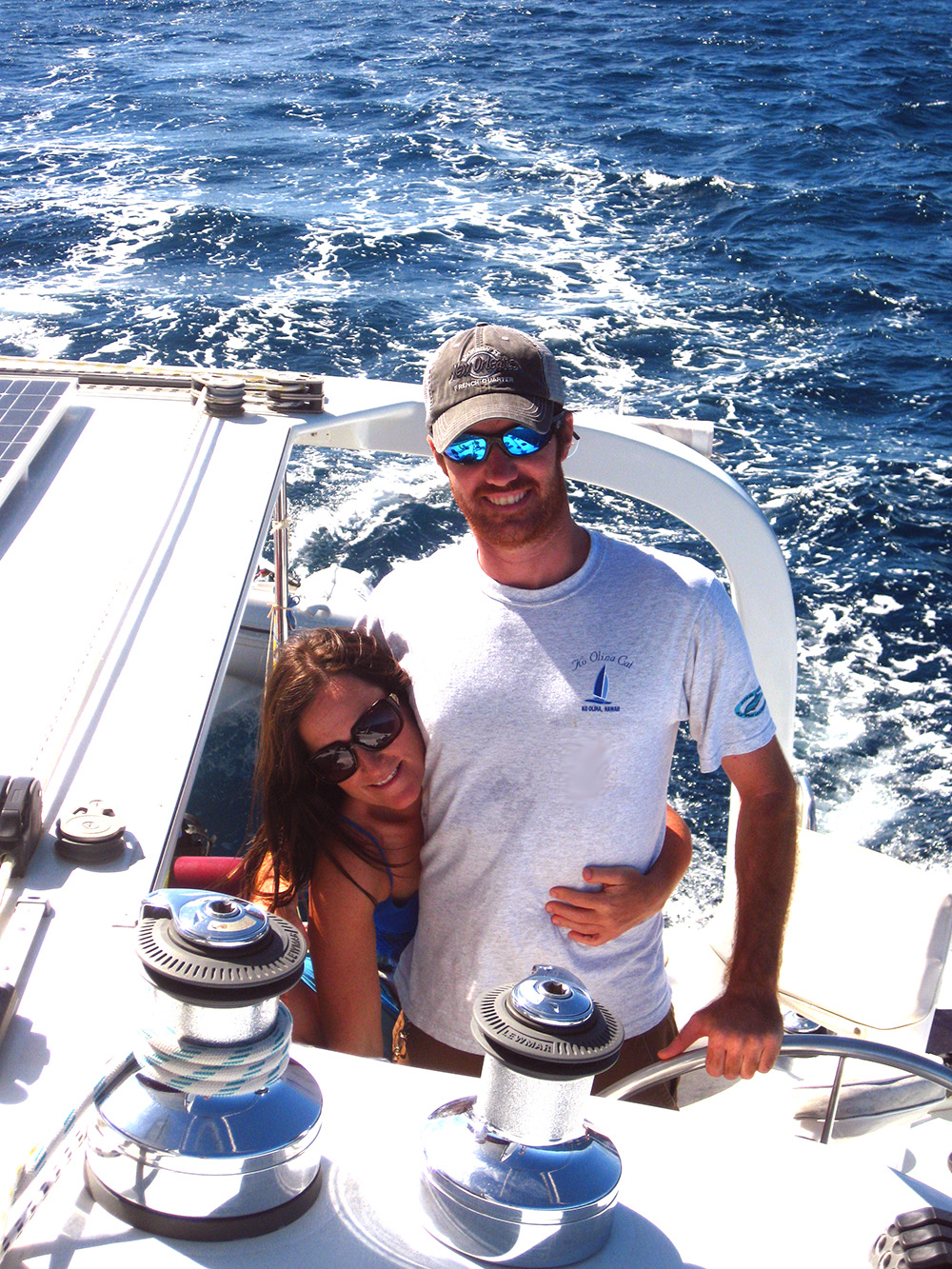 rob and tats in tonga sailing.jpg