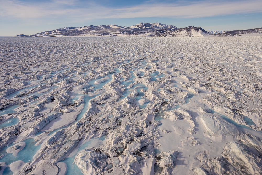 Approaching Black Island in a helicopter. We are up 900 feet, so these ice features are large. It's an area with a lot of ice pressure from the Ross Ice Shelf pushing against the land.
