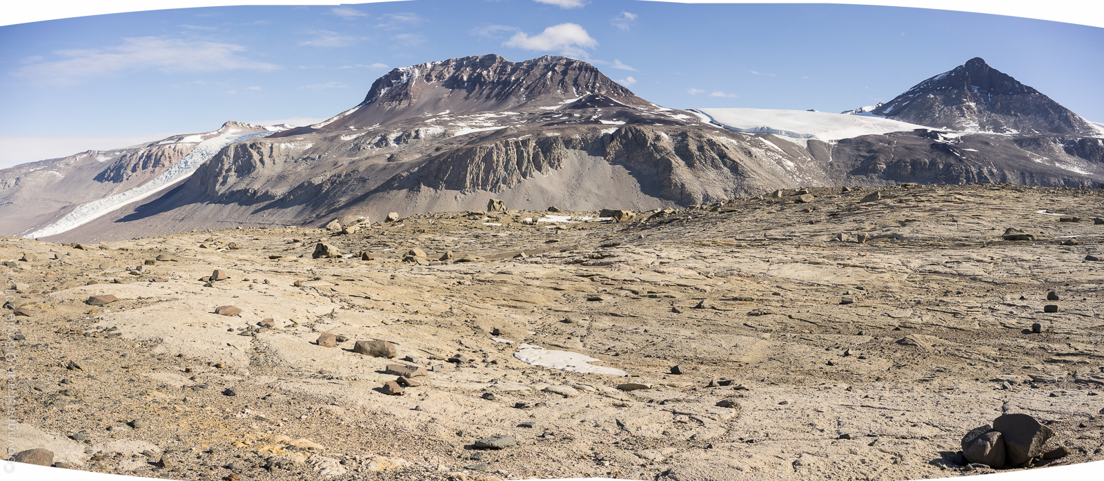 Wind scoured surface, ventifacts, mountain on right is the Matterhorn.