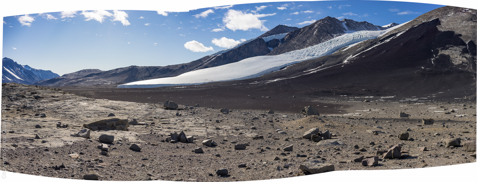 Huge field of black volcanic rock, a cone that has eroded and fractured over the last million years into a delta of marble sized rocks.