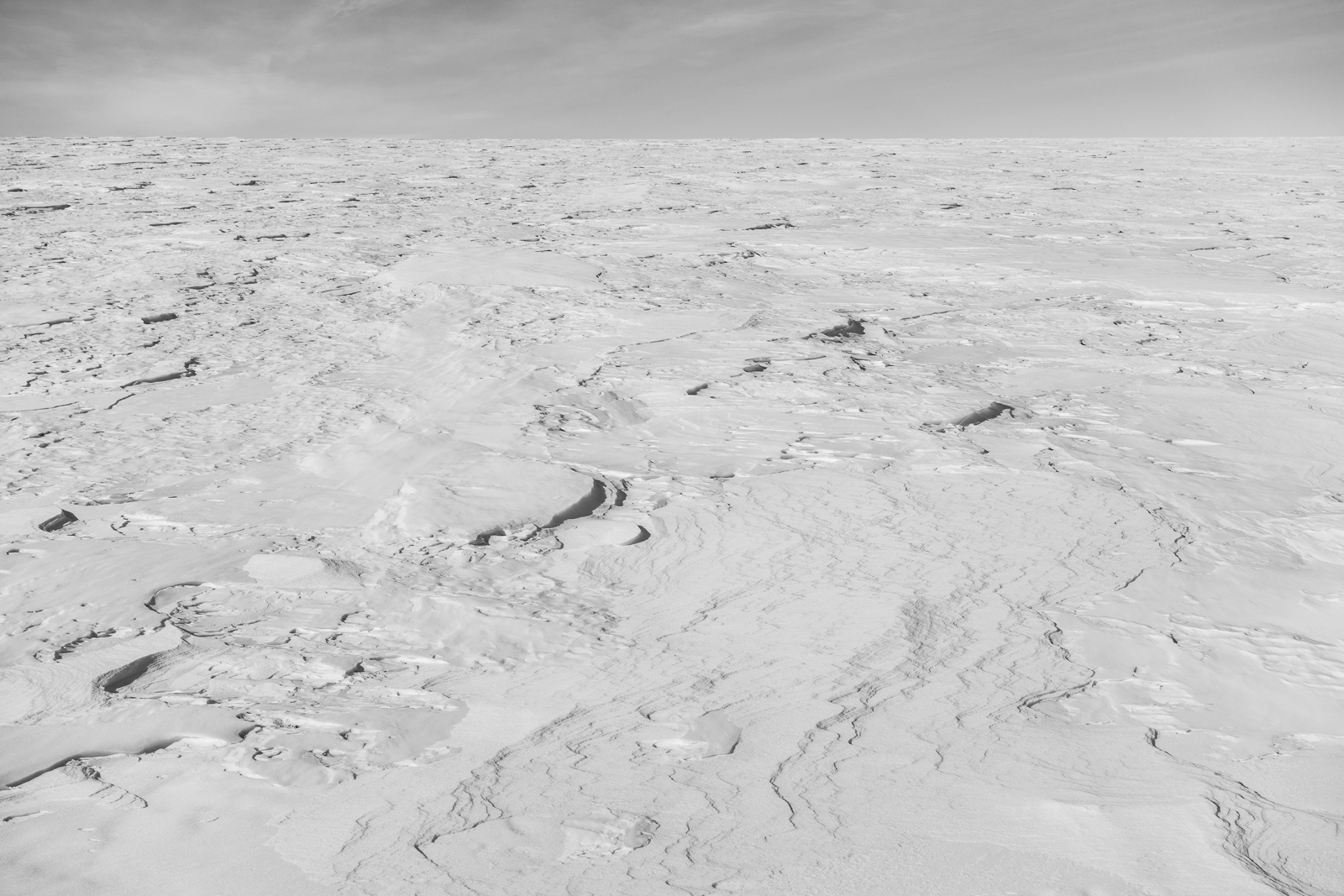 Surface of the Erebus Glacier, deceptively safe looking, but there are crevasses which get bridged over with snow but can give way when stepped on.