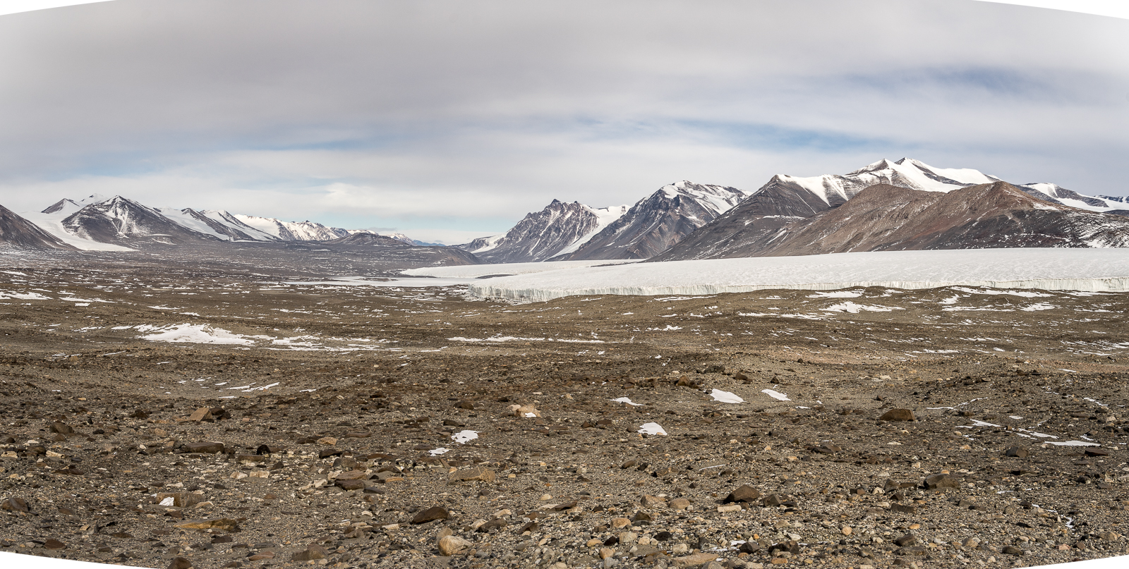 View west up the Taylor Valley. Lake Fryxell can be seen and the Commonwealth Glacier to the right.