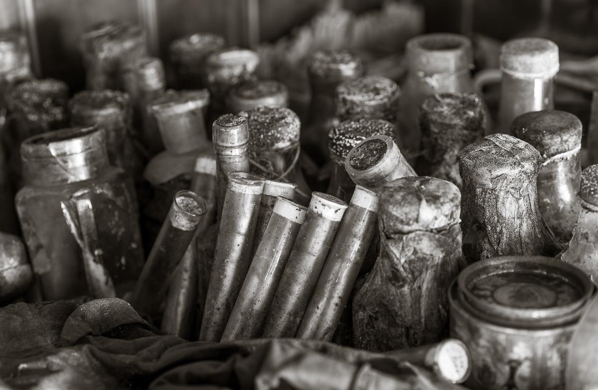 Jumble of bottles on a shelf.