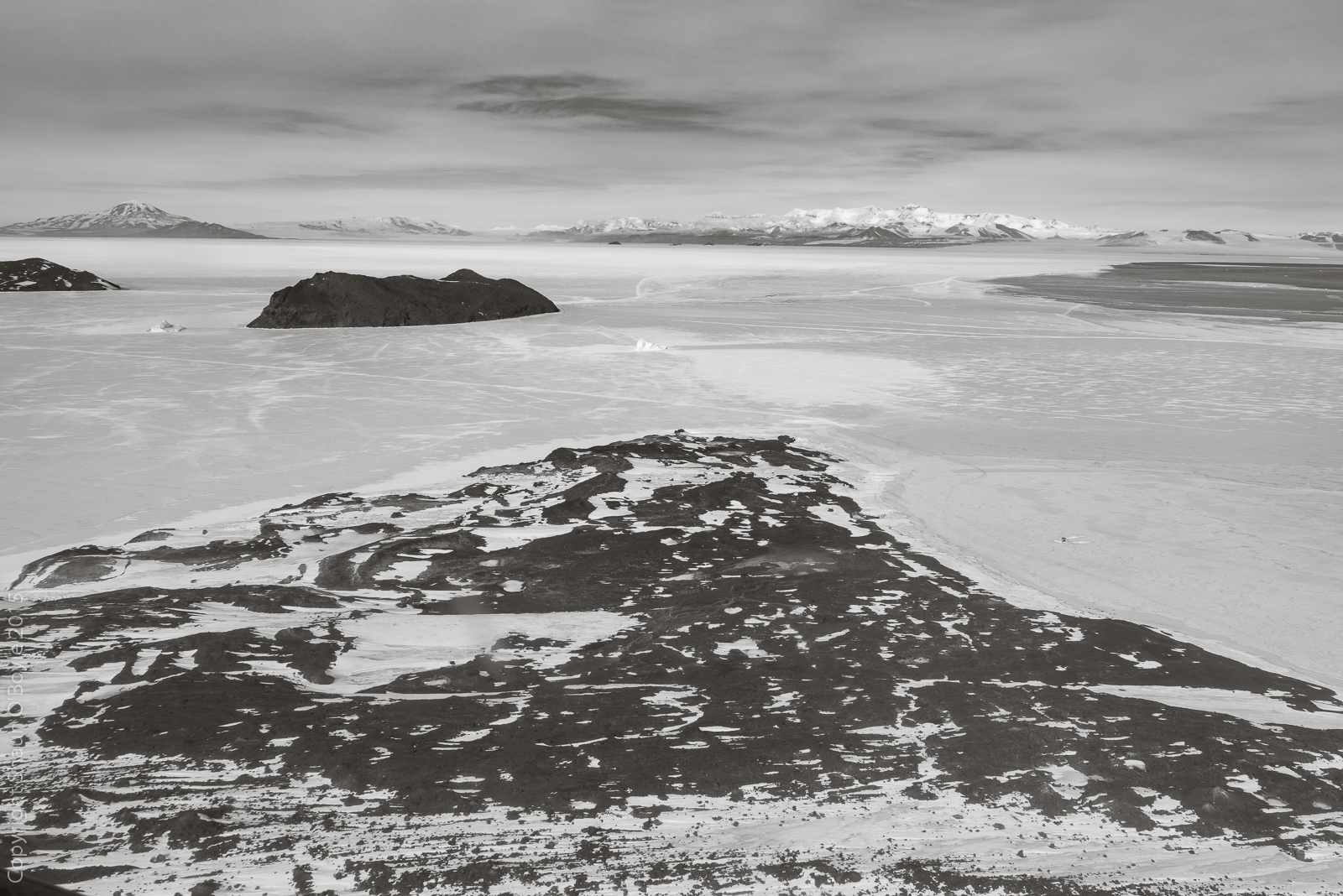 Cape Evans, where Scott's Terra Nova hut is located. Inaccessible Island in the distance.