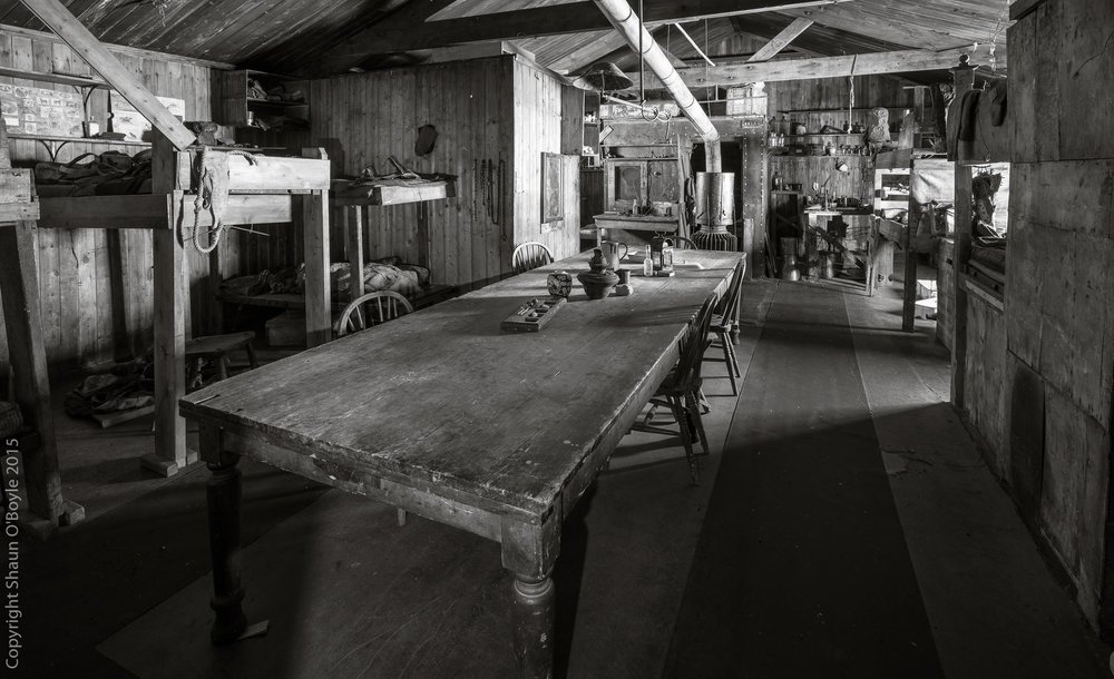 "Wardroom Table and main hut living area with the ""Tennaments"" on the left."