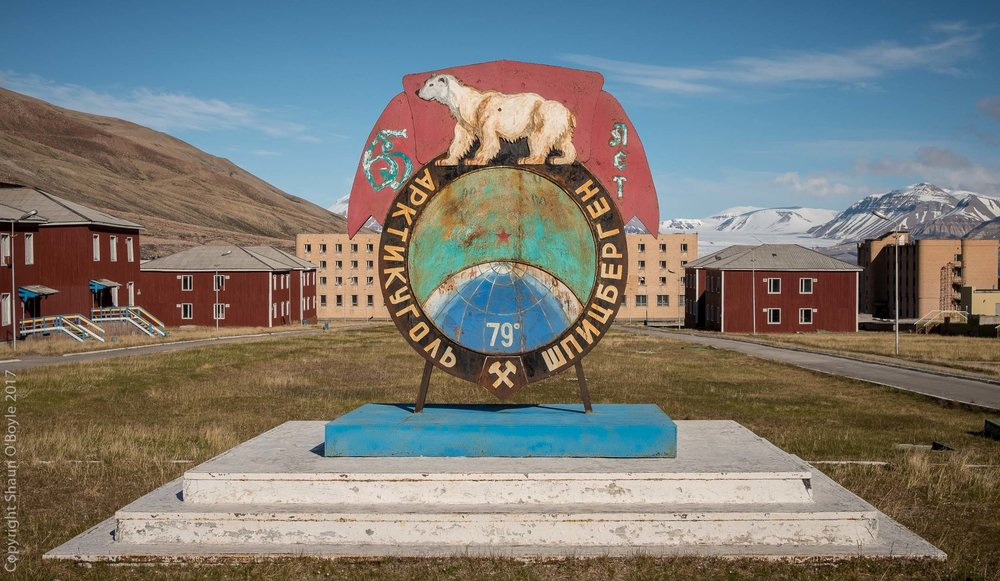 Central square of the Soviet coal mining city of Pyramiden, abandoned in 1998. The square is surrounded by apartment blocks, the Cultural Hall, Swimming Center, Schools, Hospital, and Canteen.