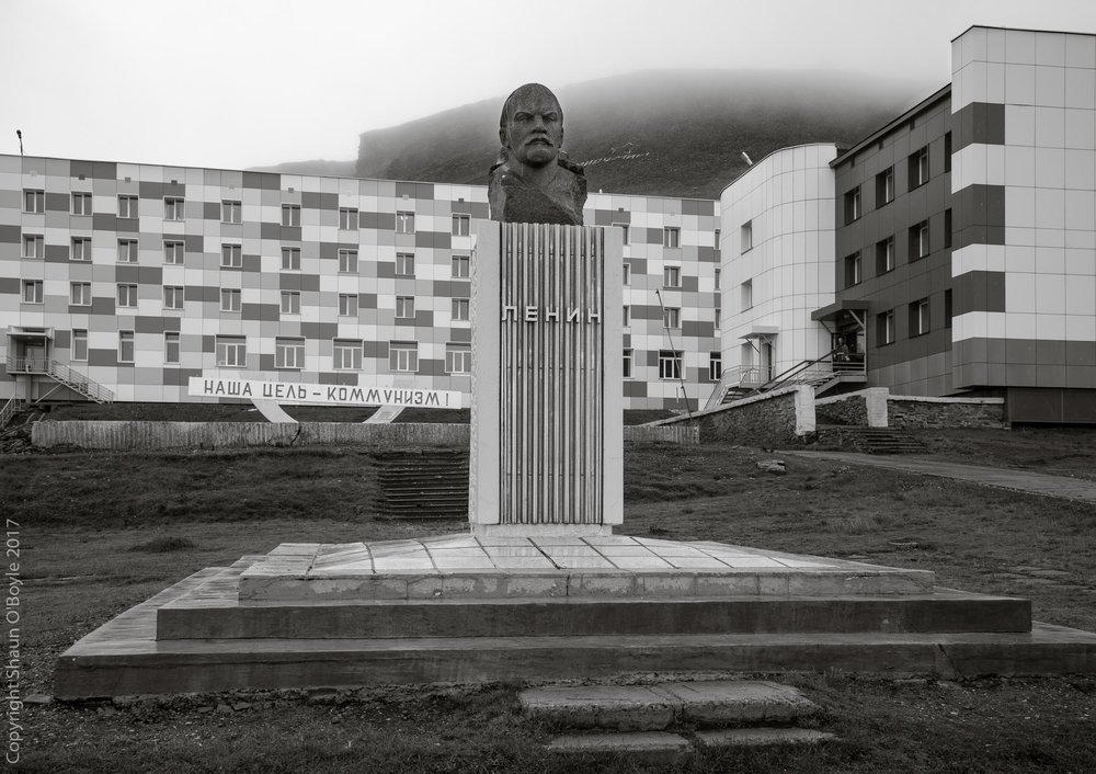 Lenin's bust in the center of Barentsburg, a Russian coal mining settlement on the island of Spitsbergen in the Svalbard archipelago. I made two visits to Barentsburg in July 2017 to photograph the settlement and the surrounding landscapes.