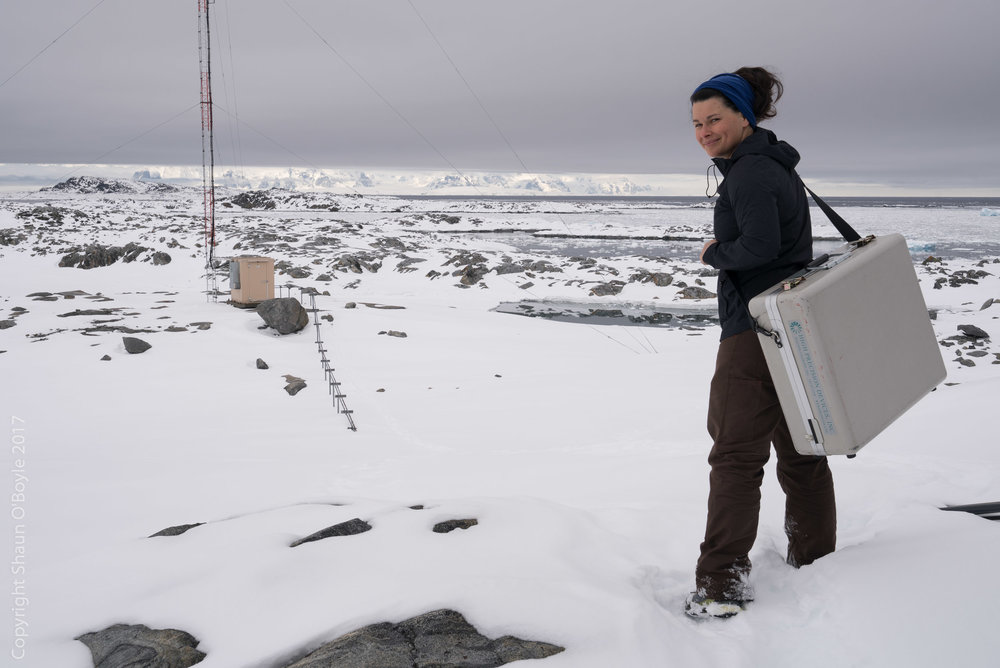 Marissa heading into the field to take air samples for the NOAA Global Greenhouse Gas Reference Network