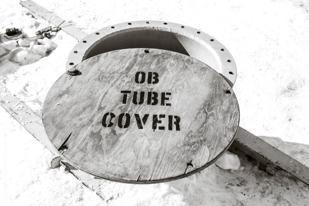 "Observation Tube, a 24"" diameter tube with ladder that leads through the ice to a glass underwater observation area."