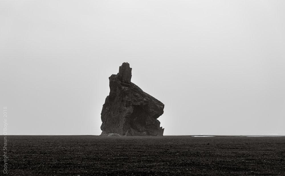 Arnardrangur at Myrdalssandur Sand Flats, Hjörleifshöfði