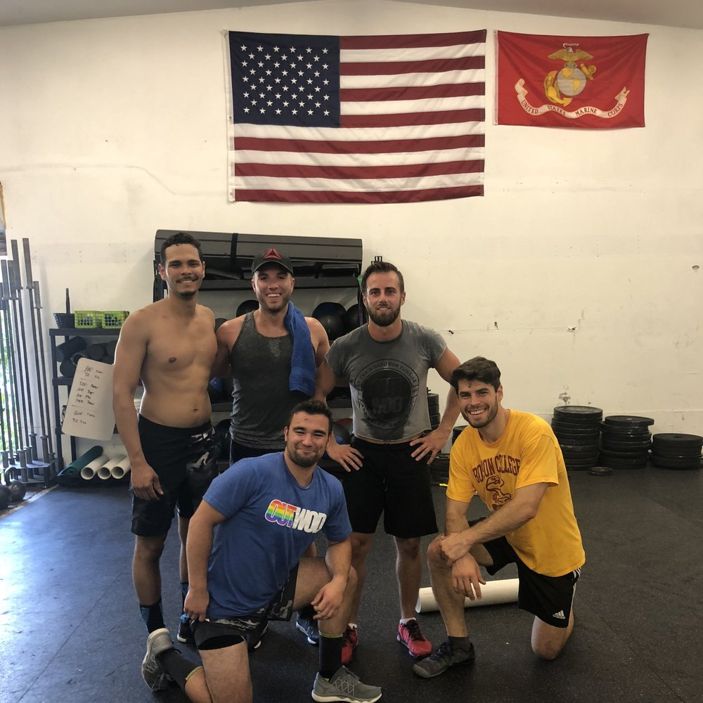 Sam (middle, front) rocking his OUTWOD shirt after a workout at his home box (CrossFit on the Hill) in Boston.