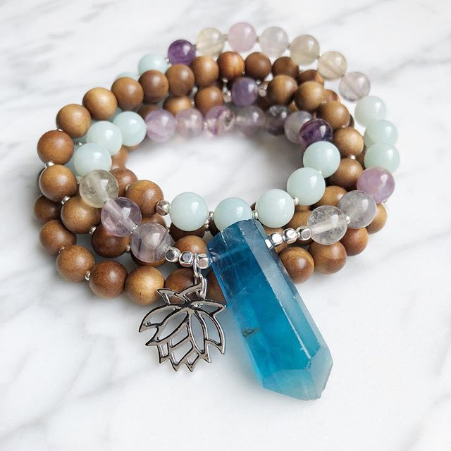 The result :: A custom Blue Fluorite, Amazonite, Purple Fluorite and Sandalwood Mala with an added Lotus charm to remind the wearer of their resilience. 💙