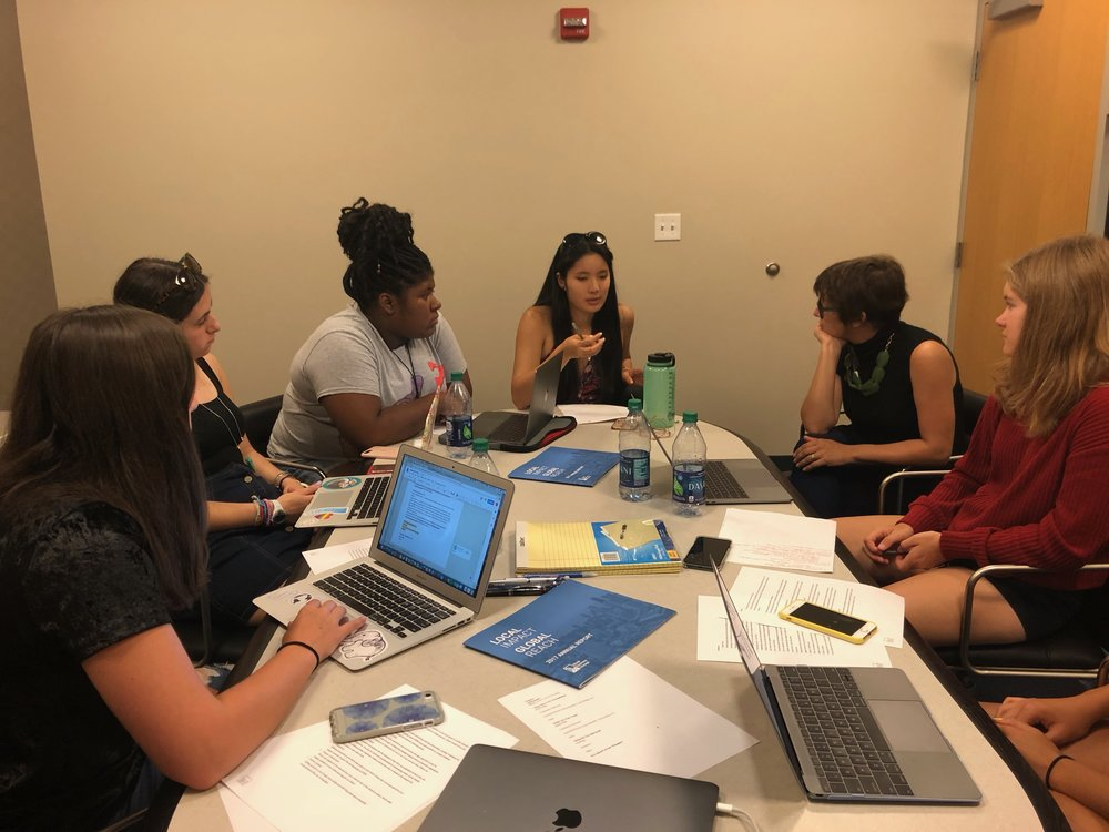 Teamwork Makes the Dream Work  Brainstorming new ideas for the 2018-2019 school year, ambassadors Hannah Davis, Jessica Flohr, Antoinette Raggs, and Ema Takahashi engage in a discussion with National Advisory Council member Emily Easton.