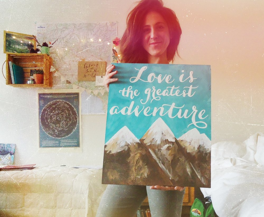 This is me holding a custom painting made for a wedding in Estes Park, Colorado.