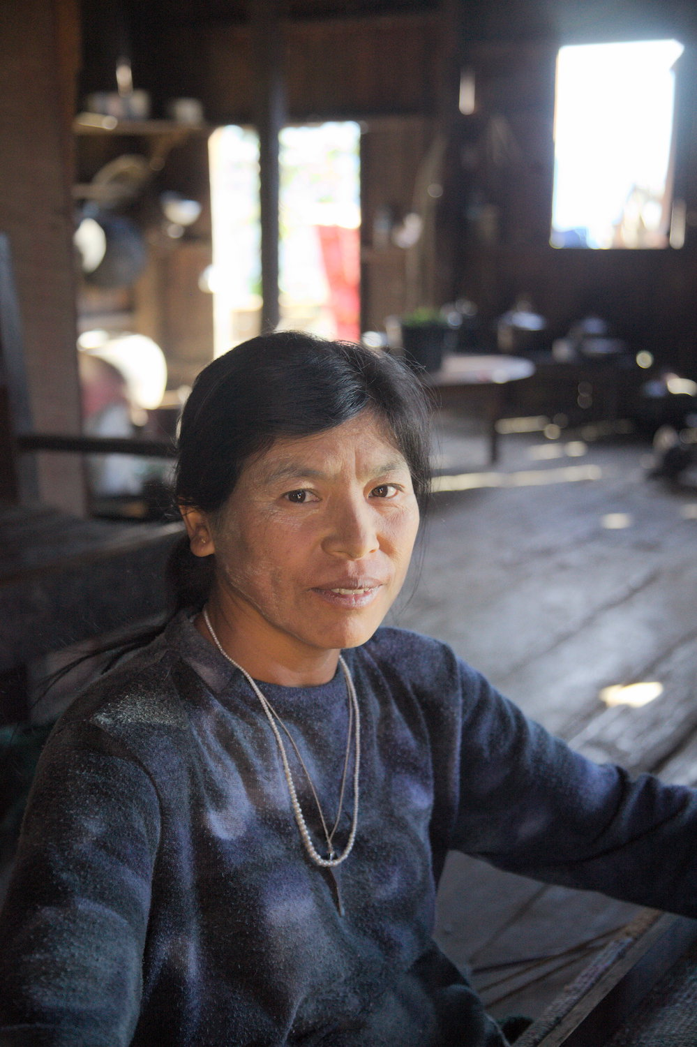 Saizang-village-Manchin-weaver-sits-at-loom.jpg