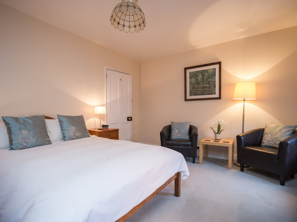 Main Bedroom  - The spacious main bedroom has one double bed and a seating area with leather armchairs. The separate private bathroom is yours to enjoy exclusively.  Double Occupancy   £85 - £95 /nightSingle Occupancy   £75 - £85 /night