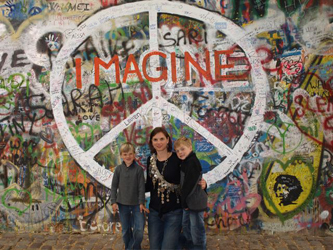 Pictured in front of the famous John Lennon Peace Wall, Prague