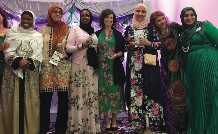 Kristen Bloom received the Service to Humanity Award by the Muslim Women's Organization of South Florida in April 2018