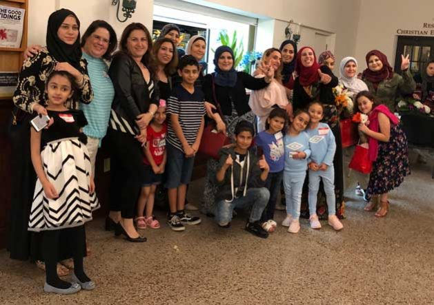 Group photo of RAA clients and board members at a special Taste of Syria event where we screened the documentary, Soufra
