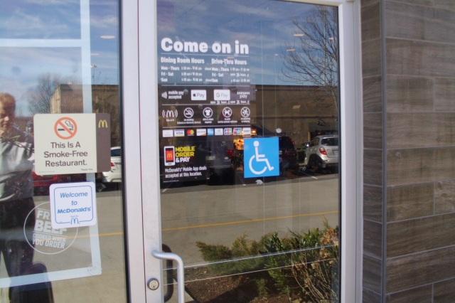 McDonald's Restaurant Entry/Exit Door with ADA Accessible Blue Sign