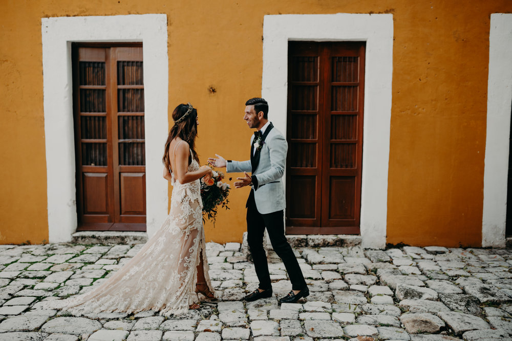 A bride and groom's first look at their Hacienda Temozon Mexico Wedding