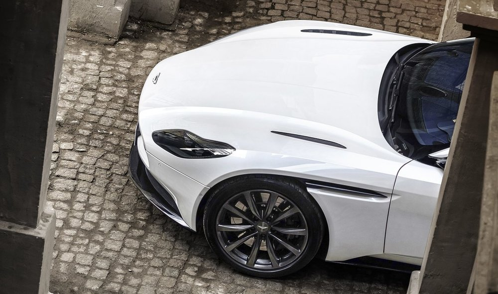 Aston Martin DB11. Cut-line between hood and fender repositioned outboard and integrated with the side vent, giving a clean appearance. Photo: Aston Martin.