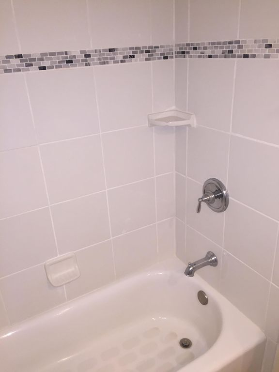 TILED TUB / SHOWER IN THIRD BATHROOM