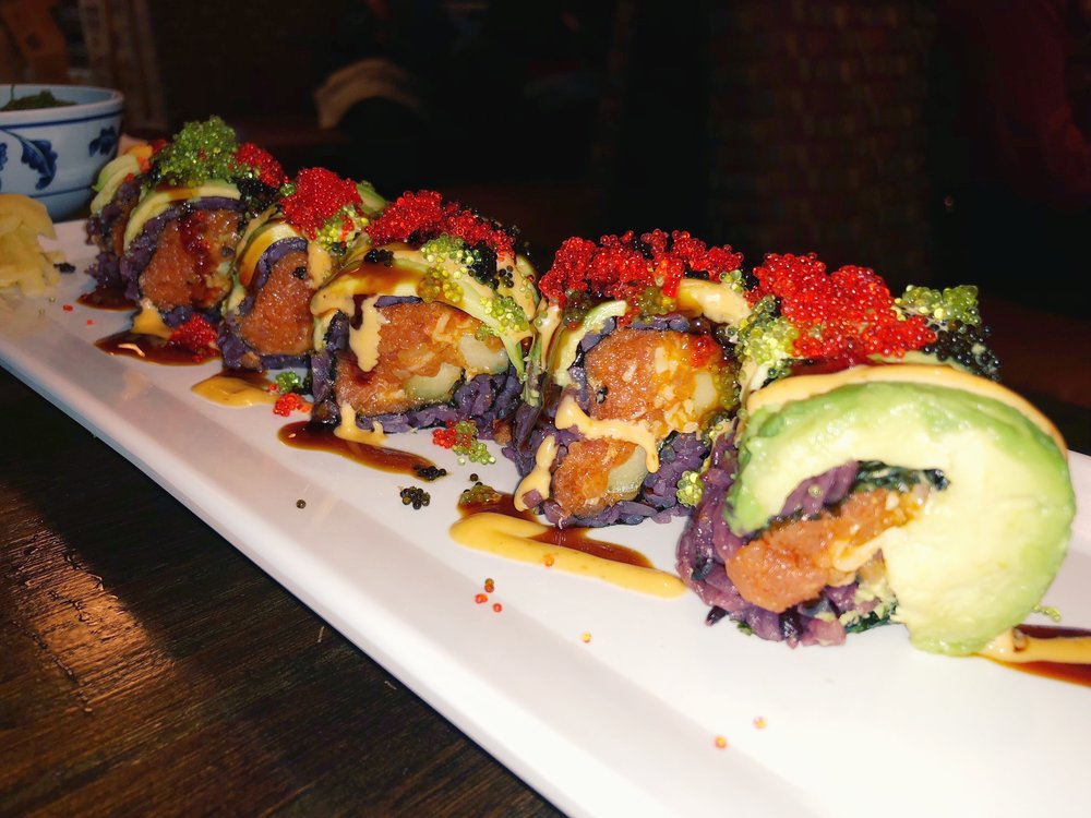 h3 roll - spicy tuna, spicy salmon, avocado, cucumber, tobiko, masago, eel sauce & spicy mayo -