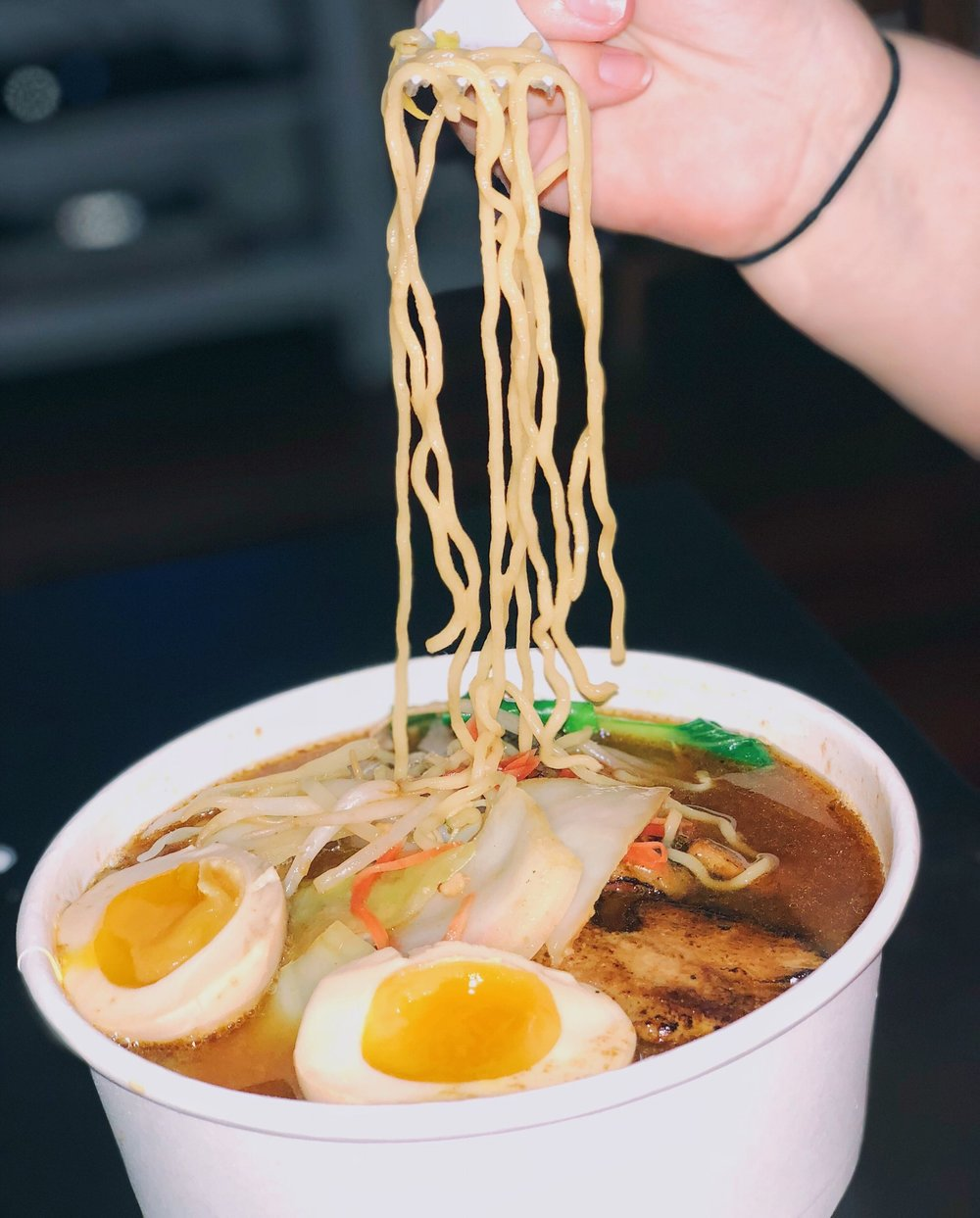 Miso - miso broth, roasted pork, egg ramen noodles, bean sprouts, cabbage, bok choy, and pickled ginger $12