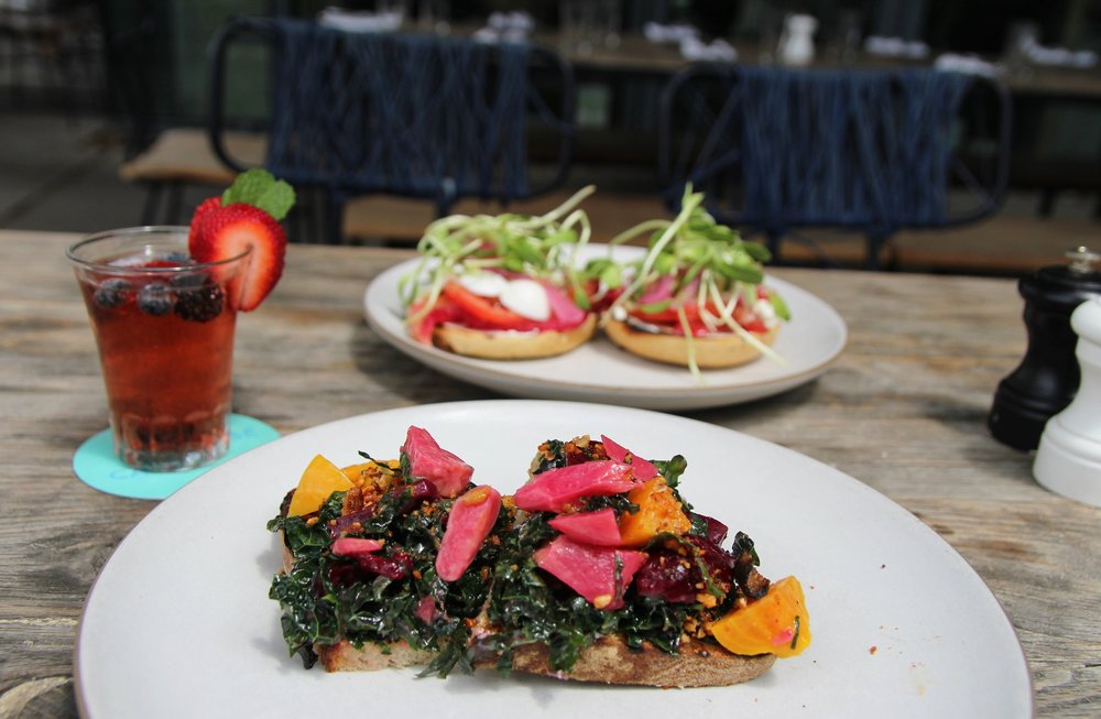 Top: Loaded gravlax bagel, beet & horseradish cured gravlax, hard-boiled egg, pickled onion, caper scallion cream cheese  Bottom: Beet toast, marinated kale, spiced pecans, whipped goat cheese