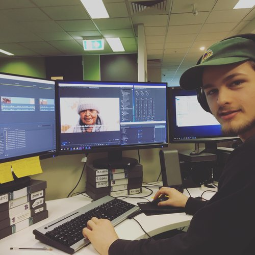 Production assistant Nate at work on Project 1 Million.