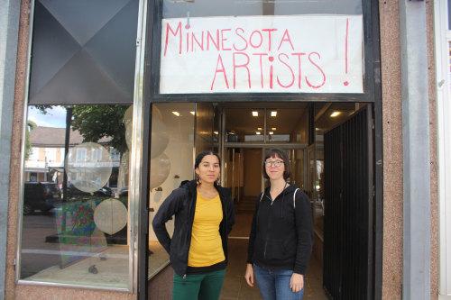 Lela Pierce & Sarita Zaleha pictured next to artwork by Zaleha