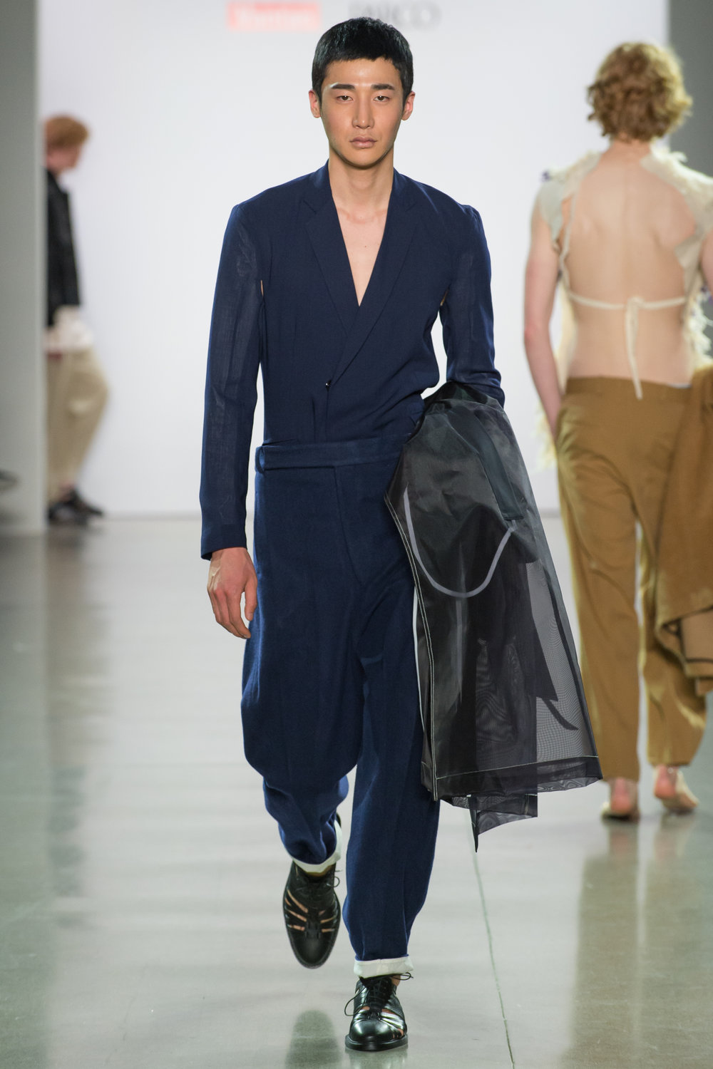 Look 2  -Patch trench coat in black extra stiff organza and poly blend technical chambray  -Back deconstruct blazer in navy wool gauze  -Big pants in navy wool melton