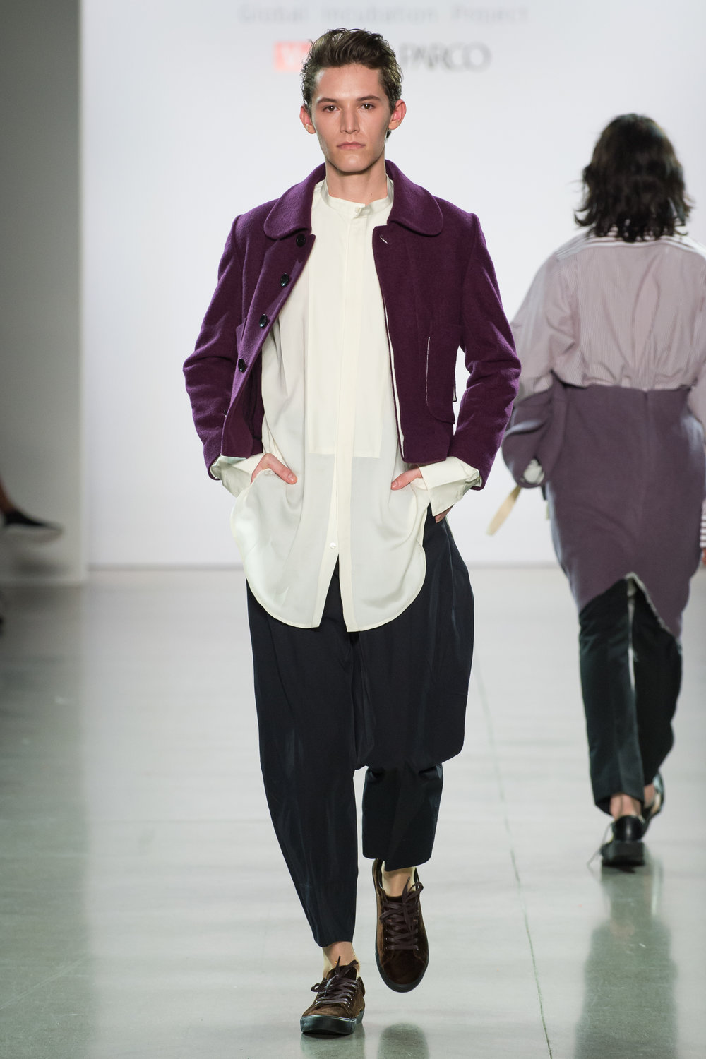 Look 7  -Cropped jacket in aubergine wool boucle  -Dress shirt in ivory double face wool satin  -Big pants in black poly blend technical chambray  -Stocking in nude with white crystals