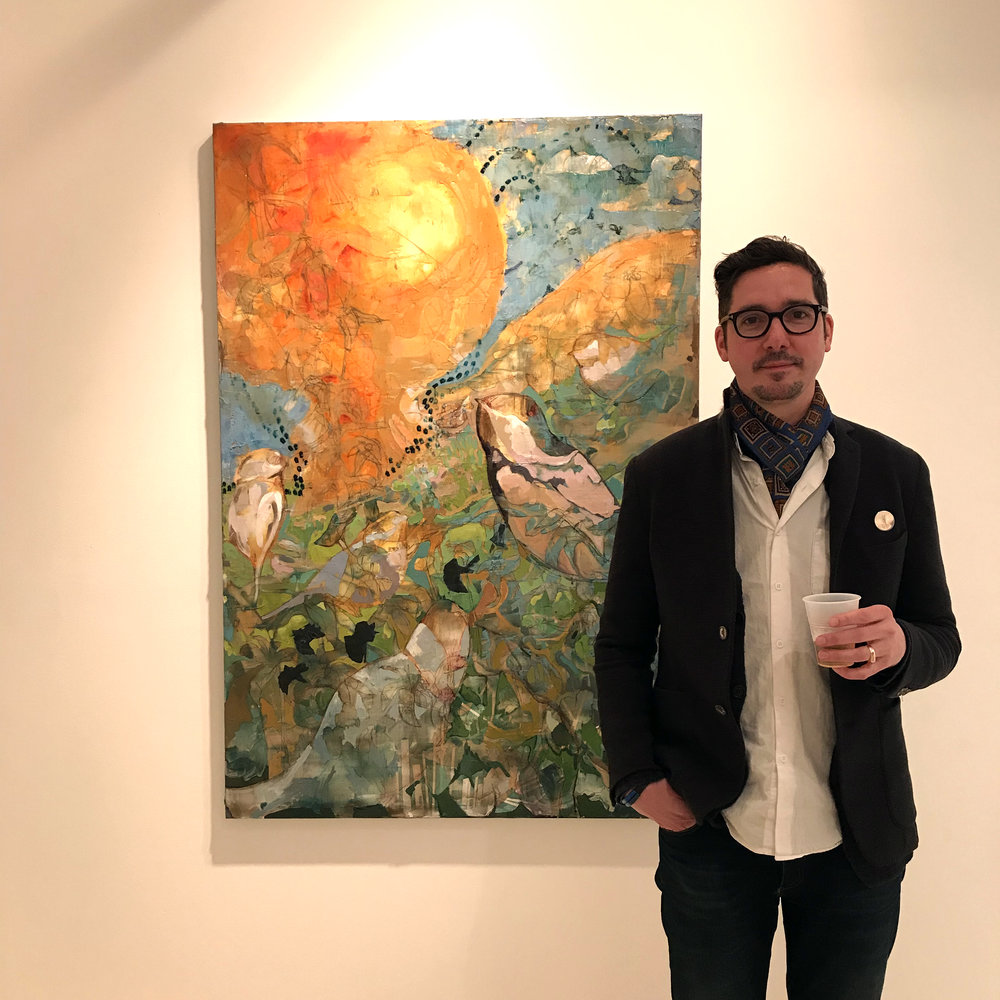 Artist David Hansen with his oil painting