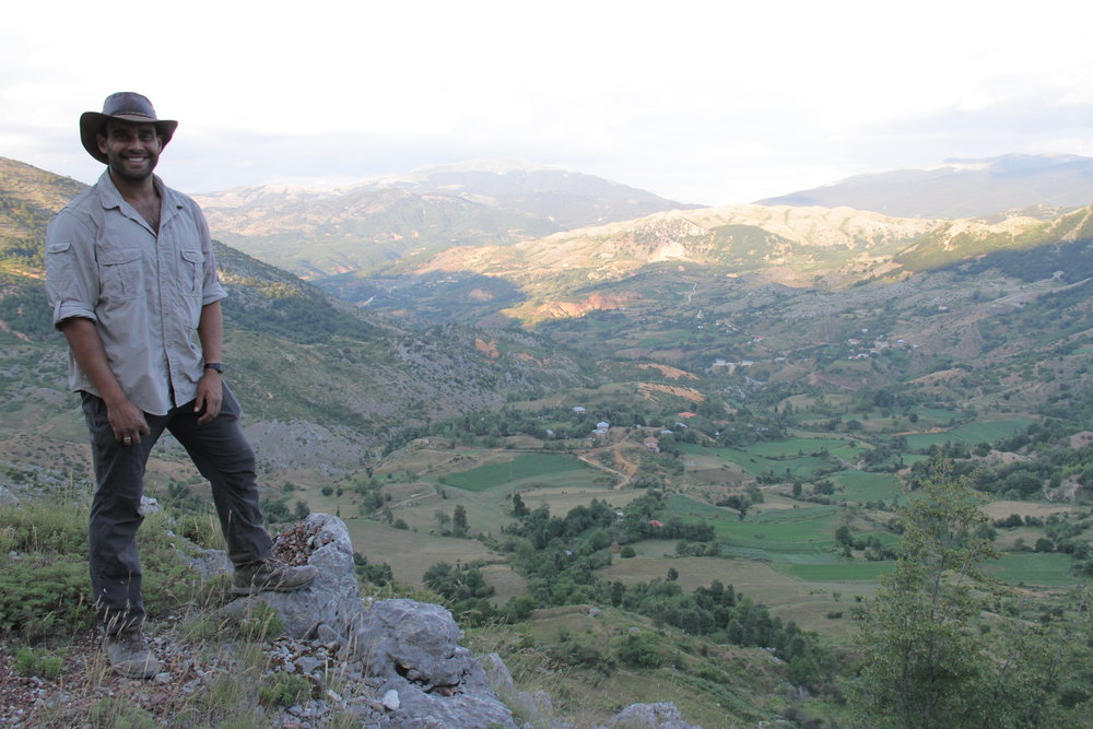 Ash Bhardwaj standing at the head of the valley that the British hid from their pursuers in.