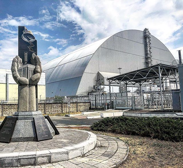 Reactor Number 4. Chernobyl. ☢️ 🇺🇦 ☢️ In 1986, this reactor overheated and exploded during a safety test, spreading radioactive material into the atmosphere. A huge area around the power station was evacuated and crews battled to contain the fire. Over six months, a containment sarcophagus was constructed over the ruined reactor to prevent the spread of any more radioactive material. ••• 30 years later, the sarcophagus was in a state of disrepair, and this new hangar was built over it. Today, it's perfectly safe to stand this close to the reactor, thanks to that sarcophagus. There are patches of higher radioactivity within the exclusion zone, usually where contaminated clean-up equipment was buried following the disaster.