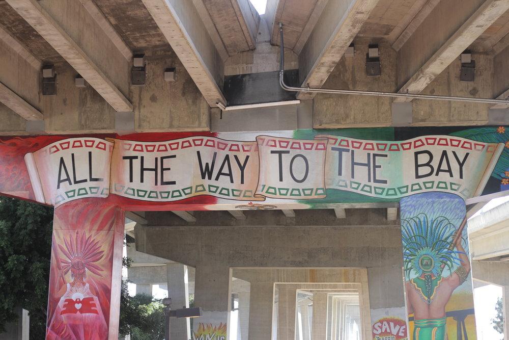 Murals under the Coronado Bridge, San Diego, with indigenous artwork and motifs.